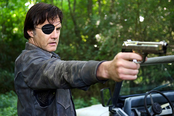 The Governor with Eye Patch Holding Beretta