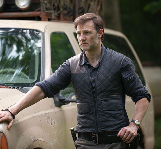 The Governor Leaning Against a Truck